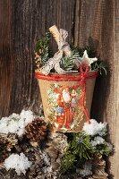 Papier mâché plant pot decorated with festive vintage scrapbook pictures