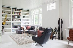 Fitted shelving and designer furniture in living room