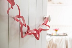 Garland of hand-made paper love-hearts