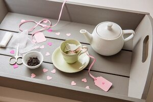 Tea set and hand-made teabags on tray