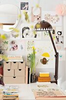 Spring atmosphere in workspace with collage of pictures on wall