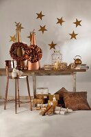 Rustic wooden table festively decorated in gold and bronze with bar stool and Christmas presents arranged on floor