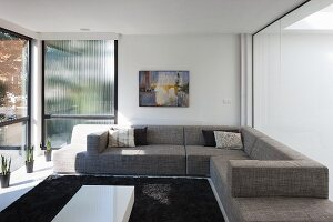 Living room with glass walls in modern building