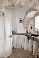 Masonry kitchen counter below arched ceiling