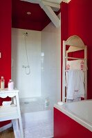 Vintage-style bathroom with red walls