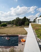 Pool area with wooden surround and view across rural landscape