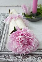 Rolled letter filled with peonies