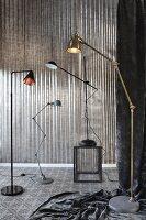 Arrangement of several standard lamps in grey interior