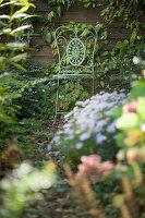 Ornate metal chair in autumnal garden