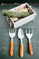 Gardening tools and reels of twine in wooden crae