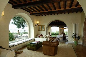 Arches and panoramic windows in Mediterranean living room
