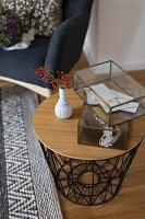 Glass display case on side table with metal frame