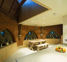 Kitchen in converted church with modern fittings, gallery and Gothic windows