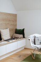 Bench with storage space and wooden panel on wall
