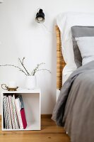 White cubic bedside table