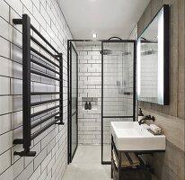 Narrow, purist bathroom with floor-level shower