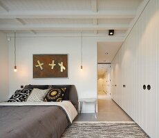 Fitted wardrobes in open-plan bedroom