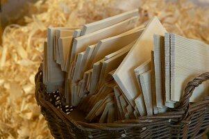 Wicker basket of wooden shingles against background of wood shavings