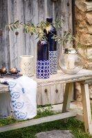 Mediterranean arrangement of ornaments on rustic wooden bench
