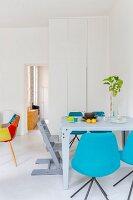 Colourful designer furniture in modern dining room