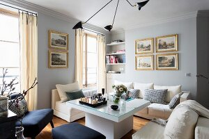 White sofa set and modern coffee table in elegant living room