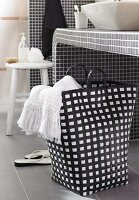 Black and white laundry bag below washstand