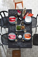 Set chalkboard table with menu written in white