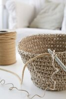 Hand-crocheted basket and crochet hook