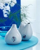 Blue arrangement with teardrop vases decorated with fish motifs