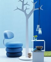 Pendant lamps hanging from white stylised tree
