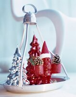 Red gnome ornament wearing Father Christmas hat on festively decorated tray