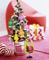 Small fir tree decorated with magic tree air fresheners and car-shaped baubles