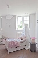Free-standing bed with canopy in vintage-style child's bedroom