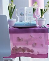 Festive Easter table decorated with menu card, elegant place setting and translucent runner