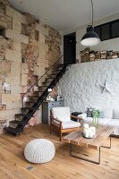 Loft apartment with rustic stone walls in converted barn