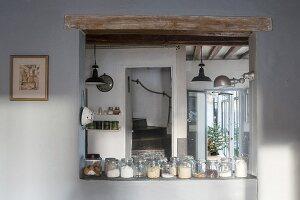 Dry goods in storage jars in serving hatch