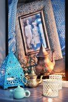 Oriental still-life arrangement of lanterns and teapots