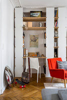 Floor-to-ceiling shelving with integrated desk