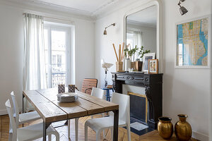 Wooden table and plastic chairs in dining room of period apartment