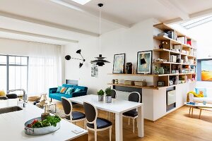 Modern table, Baroque chairs and corner shelving in dining room