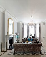 Open fireplace and crystal chandelier in elegant lounge