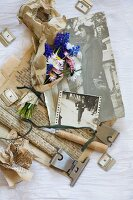Spring posies of grape hyacinths and daisies wrapped in vintage paper and arranged with vintage-style utensils