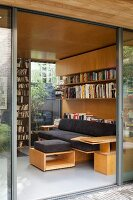 View of custom bookcase and sofa with integrated table