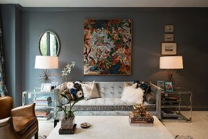 Grey wall and symmetrical side tables in glamorous living room