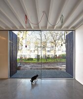Minimalist interior with concrete floor and terrace doors