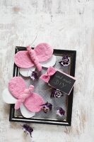 Hand-made gift tag, pink felt butterflies and purple flowers on black vintage picture frame