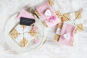 a coasters with pink felt covers and heart-shaped buttons