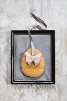 Easter decoration with butterfly motif in vintage picture frame