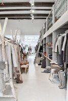 Wooden clothes racks in clothing store