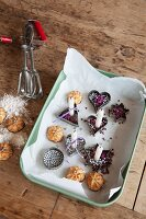 Christmas biscuits and Christmas-tree candles arranged in pastry cutters